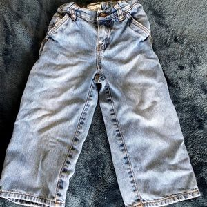 Jeans with elastic straps